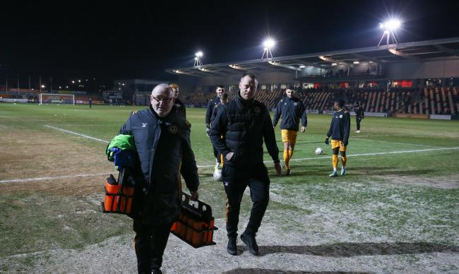 FROZEN OUT: Michael Flynn, centre, leaves the pitch after Tuesday's game with Leicester U21s is called off