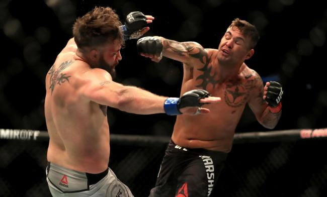 TOUGH TEST: Jack Marshman, right, fights Kevin Holland. Picture: Simon Cooper/PA