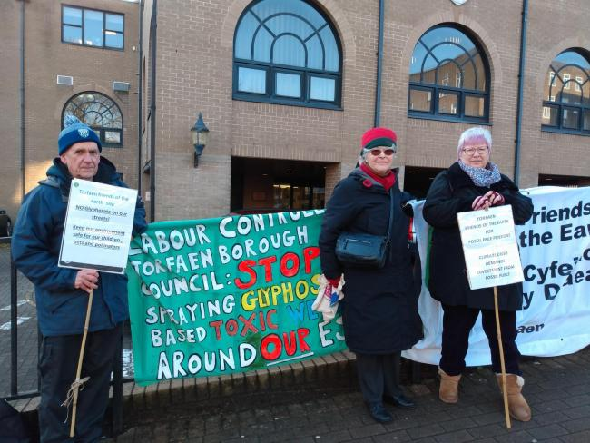 From left: Campaigners Terry Banfield, Carole Jacob and Corinne Jones protesting outside the civic centre in Pontypool against Torfaen council's continued use of glyphosate-based weedkiller