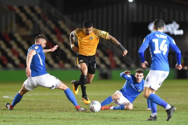 RIVALS: Joss Labadie of Newport County beats the Macclesfield Town defence in the January clash at Rodney Parade