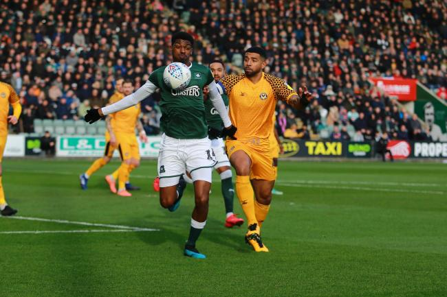 BATTLE: Plymouth Argyle's Tyreeq Bakinson tussles with former Newport County teammate Joss Labadie at Home Park. Pictures: Huw Evans Agency