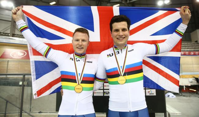 WORLD GLORY: James Ball, left, and pilot Lewis Stewart show off their gold medals. Picture: British Cycling