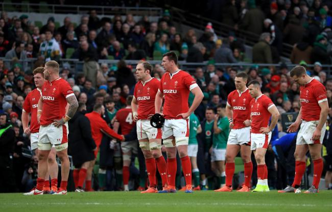 Wales players stand dejected after the Guinness Six Nations match at the Aviva Stadium, Dublin. PA Photo. Picture date: Saturday February 8, 2020. See PA story RUGBYU Ireland. Photo credit should read: Donall Farmer/PA Wire. RESTRICTIONS: Editorial use on