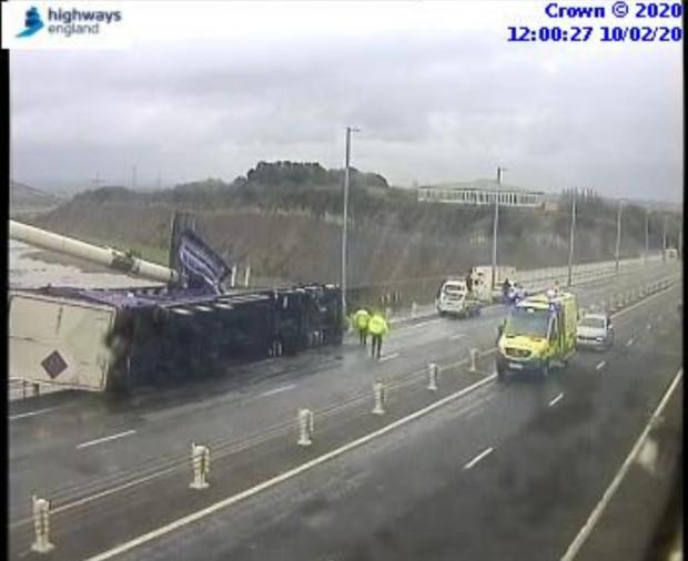 South Wales Argus: The overturned lorry on the M48 Severn Bridge eastbound. Emergency services are at the scene. Picture: Highways England
