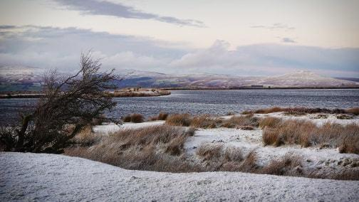 South Wales Argus: Snow on the Brecon Beacons, taken from the Keepers Pond, near Blaenavon. Picture: South Wales Argus Camera Club member Craig Titchener