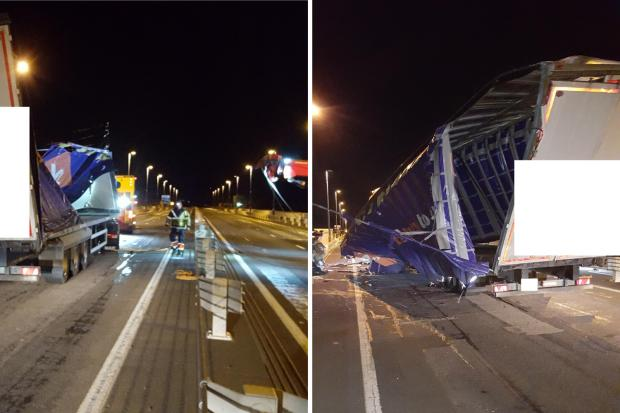 South Wales Argus: The lorry (with identifying marks blocked out) was righted and removed from the Severn Bridge on Tuesday evening by recovery crews. Pictures: Highways England/Twitter