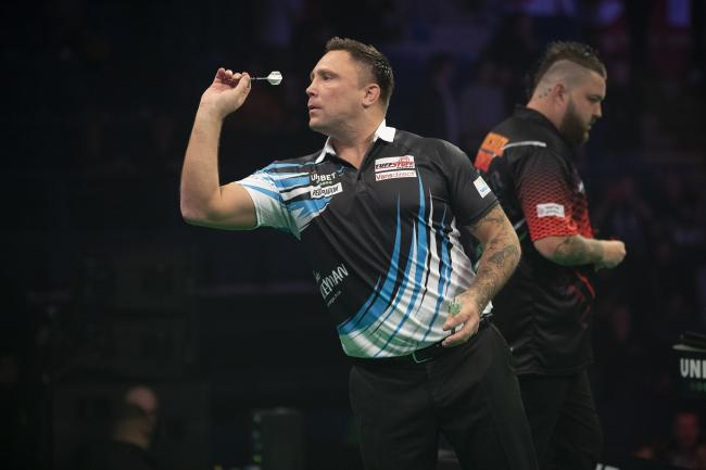 FIGHTBACK: Gerwyn Price in action against Michael Smith in Nottingham. Picture: Lawrence Lustig