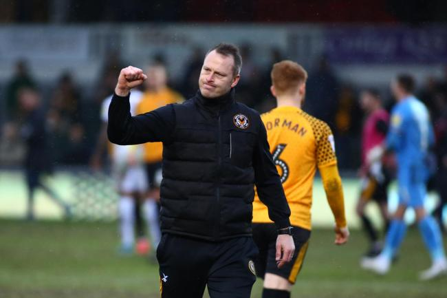 VICTORY: Newport County manager Michael Flynn celebrates after the final whistle against Bradford City. Pictures: Huw Evans Agency