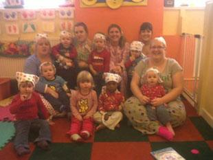 Staff and some of the children who have raised nearly £400 for children in need, from  Kites Nursery Newport, Queens Hill Crescent.