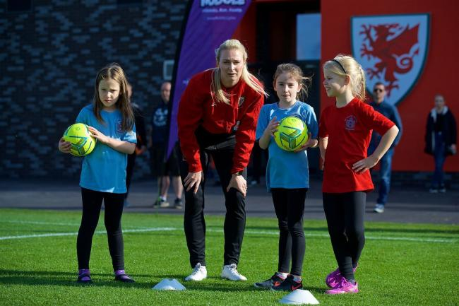 EXPERIENCE: Wales international Rhiannon Roberts with girls at a Huddle training session. Picture: FAW