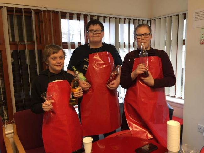 Jamie Dobbs, Connor Nicklin and Mollie Chislett welcome guests with drinks at the Come Dine With Us event