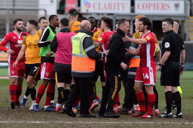 MELEE: Newport County players and coaching staff scuffled with their Morecambe counterparts after the 1-0 win at Rodney Parade. Pictures: Huw Evans Agency