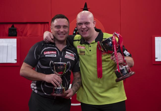 CLASSIC ENCOUNTER: Gerwyn Price, left, and Michael van Gerwen after the Ladbrokes UK Open final. Picture: Lawrence Lustig/PDC