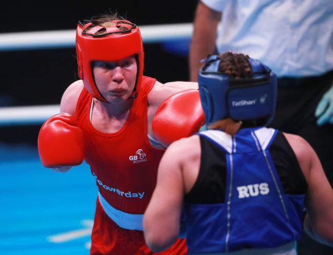 DEFEAT: Rosie Eccles, in red, in action against Russia's Saadat Dalgatova at the Boxing Road to Tokyo 2020 Olympic qualifying event on Sunday