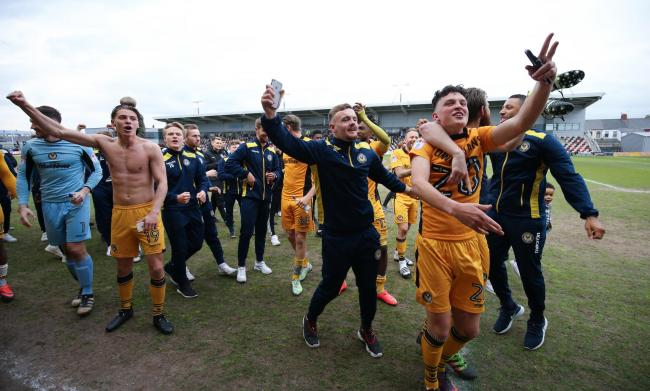 MEMORIES: Tom Owen-Evans, right, celebrates with his Newport County teammates after completing the Great Escape in May 2017