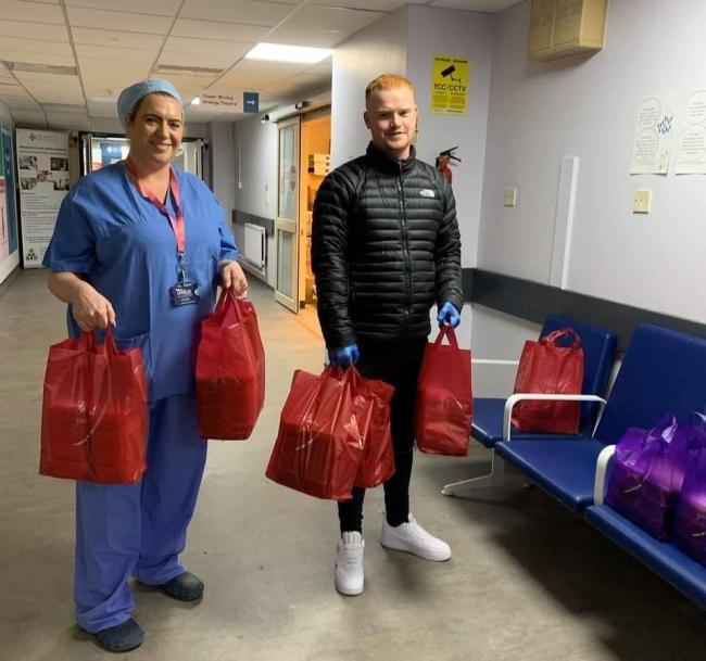 Jack Price, general manager of Dragon Taxis Newport and Torfaen, delivering free meals to NHS staff at the Royal Gwent Hospital. Picture: Dragon Taxis