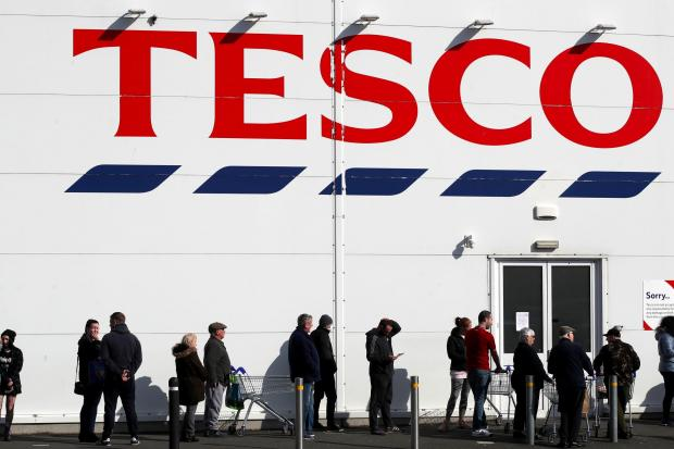 South Wales Argus: People queue outside a Tesco Extra store in Madeley, Shropshire