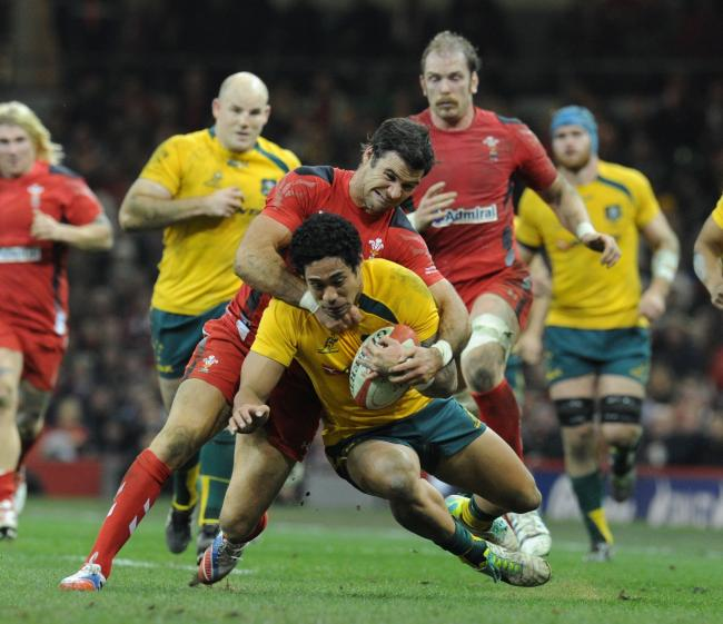 TARGET: The Dragons made a move for former Australia back Joe Tomane, pictured playing against Wales in 2013