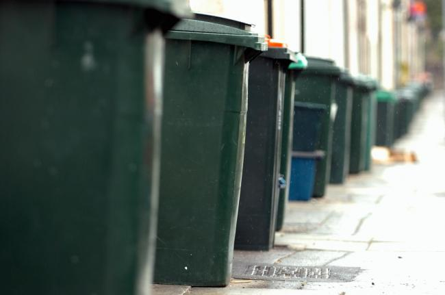 Stock picture of wheelie bins.