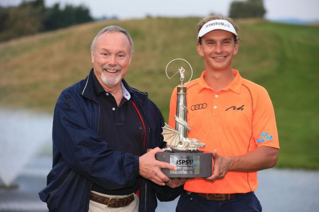 WINNER: Joost Luiten holds the trophy after winning the 2014 Wales Open with owner of Celtic Manor Sir Terry Matthews