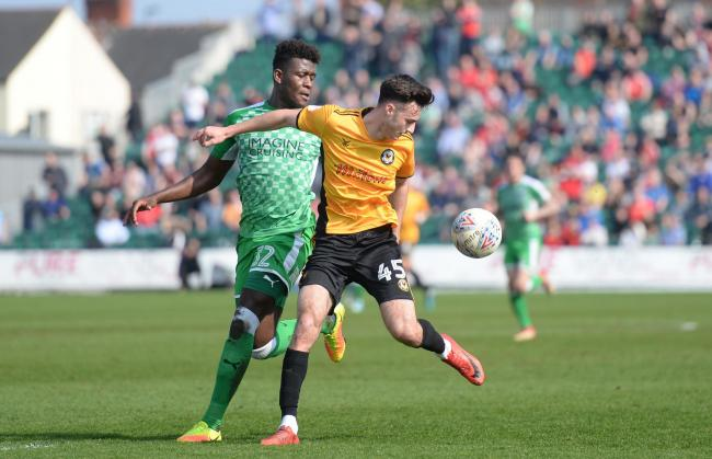 PROSPECT: Defender Rollin Menayese, in action for Swindon at Rodney Parade, has signed a new Bristol Rovers deal