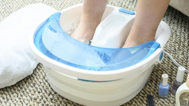South Wales Argus: Soak your feet to soften the skin around corns. Credit: Reviewed / Betsey Goldwasser