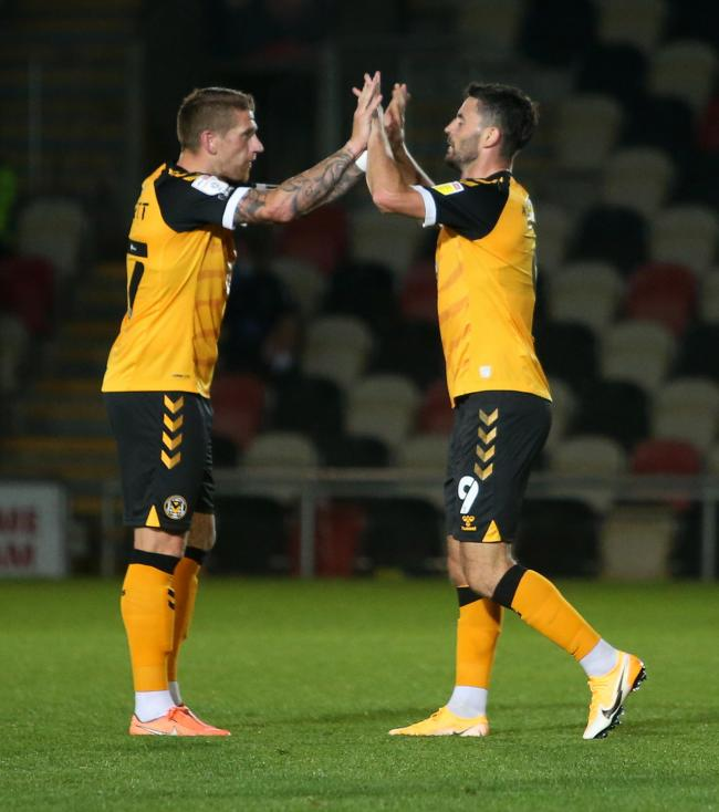 BACK: Midfielder Scot Bennett celebrates with Padraig Amond after his return to Newport's side