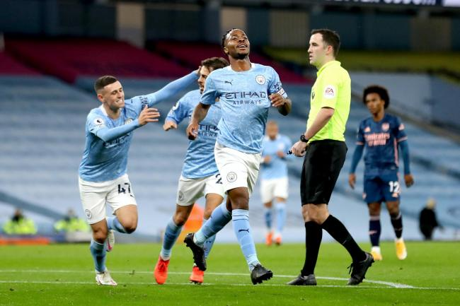 Raheem Sterling celebrates his match-winning goal against Arsenal