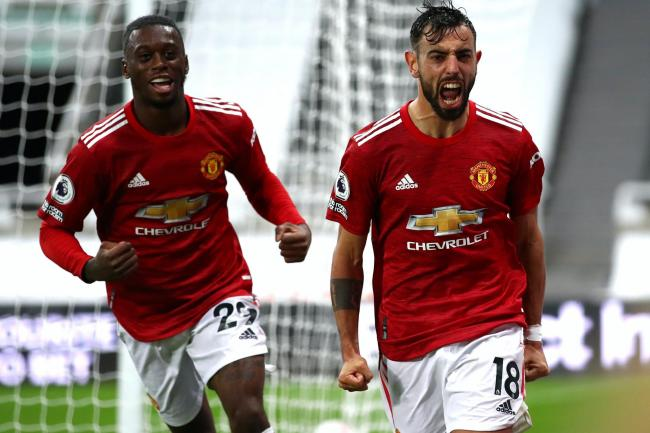 Manchester United's Bruno Fernandes (right) celebrates his goal at Newcastle