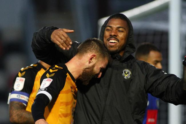 DELIGHT: Tristan Abrahams congratulates Brandon Cooper after his late winner