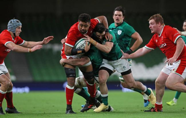 DEFEAT: Wales number eight Taulupe Faletau is smashed by the Irish defence