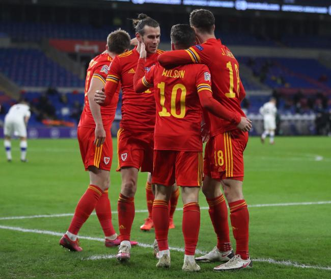 Wales' Harry Wilson (centre) celebrates scoring his side's first goal of the game with assistant Gareth Bale (left) during the UEFA Nations League match at Cardiff City Stadium. PA Photo. Picture date: Wednesday November 18, 2020. See PA story SOC