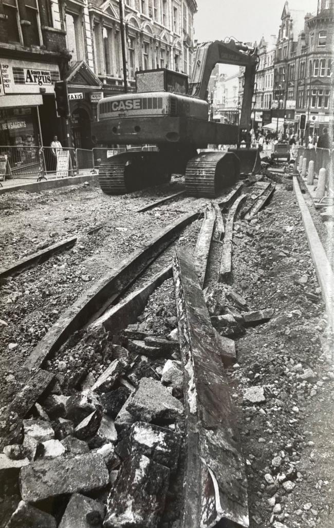 HISTORY: This is a picture of tram lines in High Street, Newport, being uncovered and then covered during road resurfacing in 1993