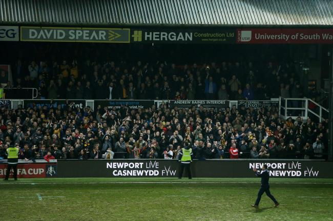 PACKED: Michael Flynn applauds the Newport crowd after the 2018 draw with Spurs
