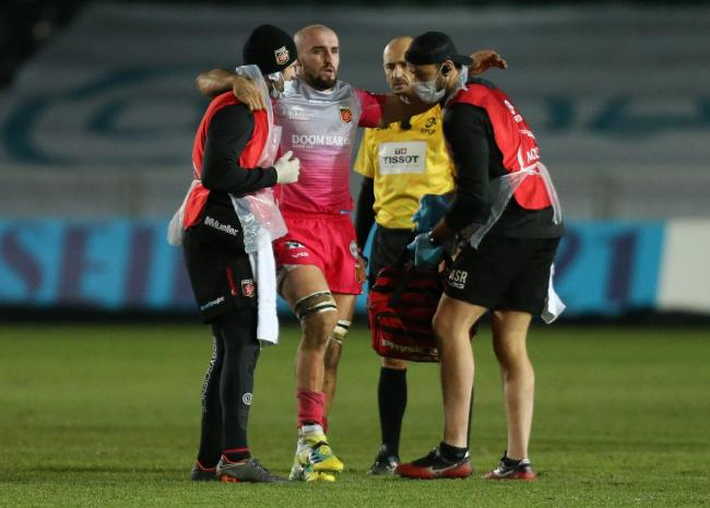 BLOW: Ollie Griffiths is helped
