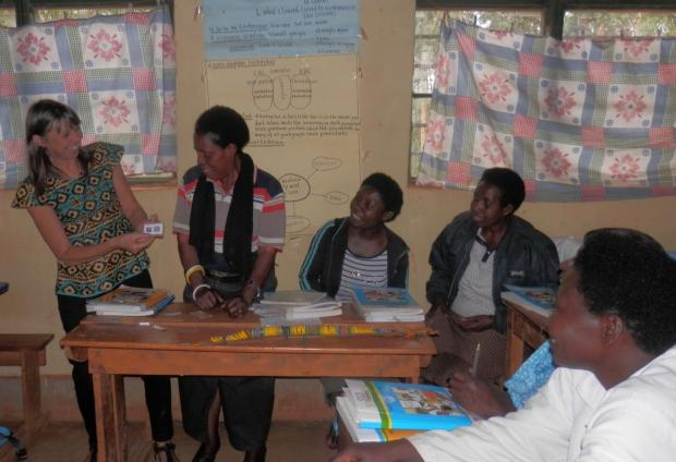 South Wales Argus: Mary Watkins working with teachers in Rwanda to develop classroom materials and learning aids.
