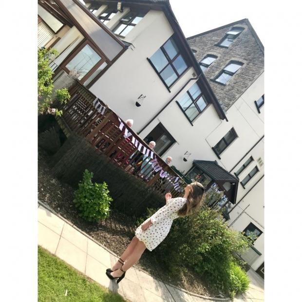 South Wales Argus: Laura Sidney performing at Panteg Nursing Home for VE Day (2020)