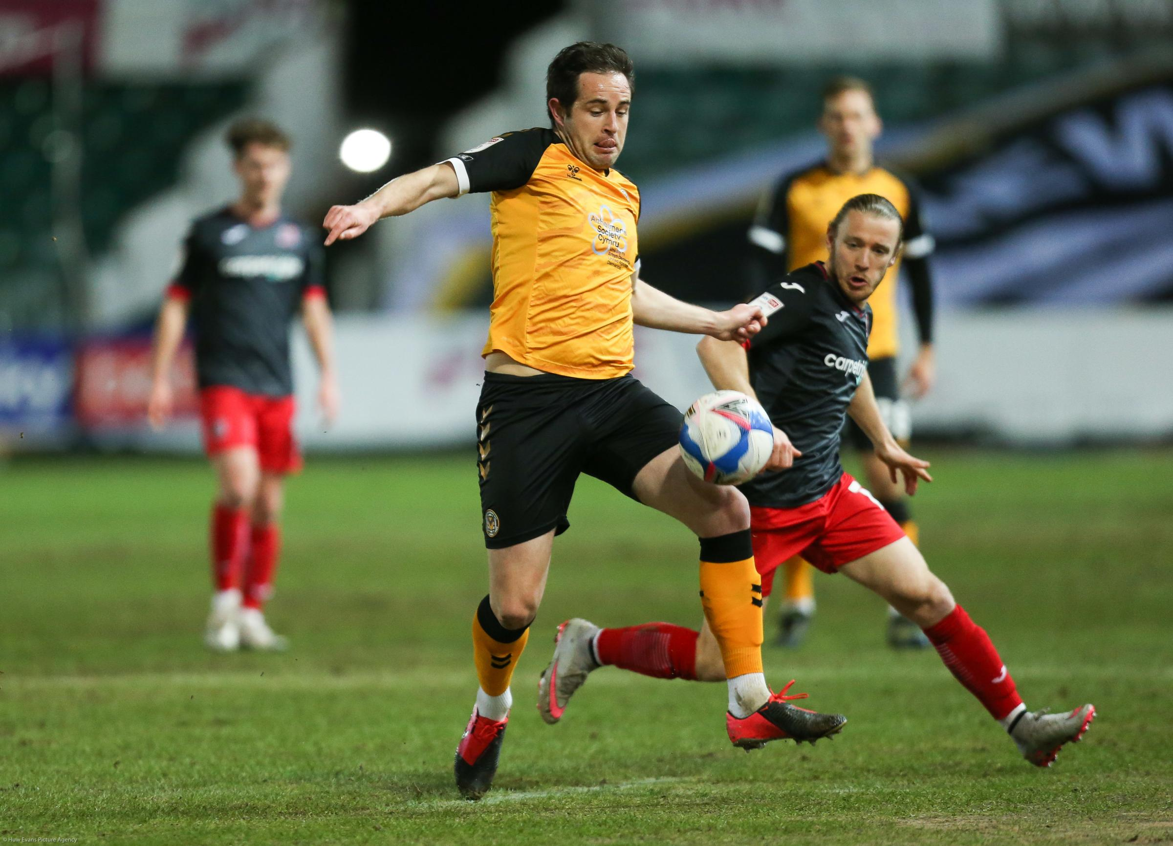 16.02.21 - Newport County v Exeter City, Sky Bet League 2 - Matty Dolan of Newport County wins the ball.