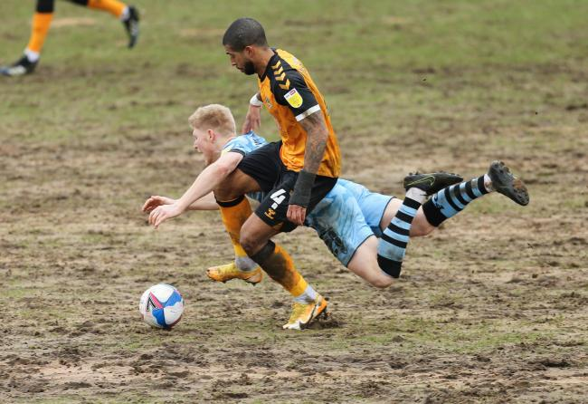 Joss Labadie battles for possession at Rodney Parade