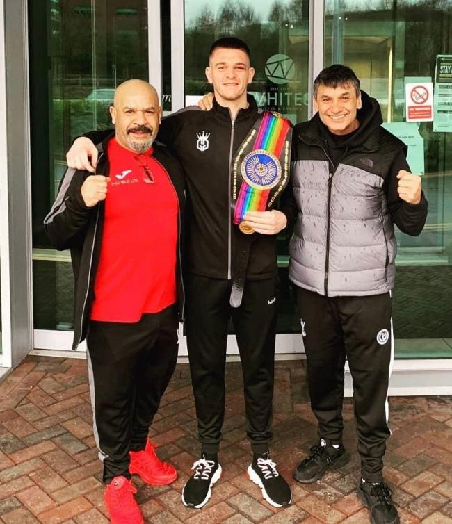 PRIDE: Gavin Gwynne shows off his Commonwealth belt with trainer Tony Borg, left, and manager Chris Sanigar