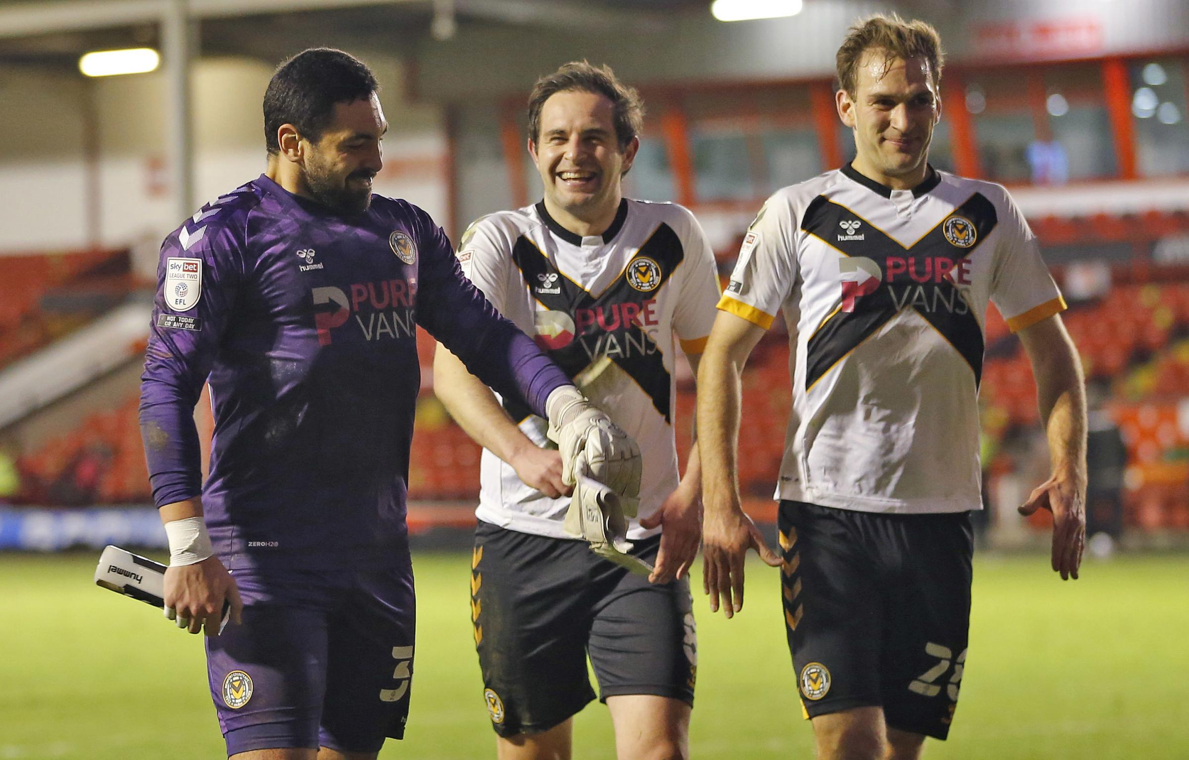 GUTSY: Nick Townsend, Matty Dolan and Mickey Demetriou after the clean sheet at Walsall