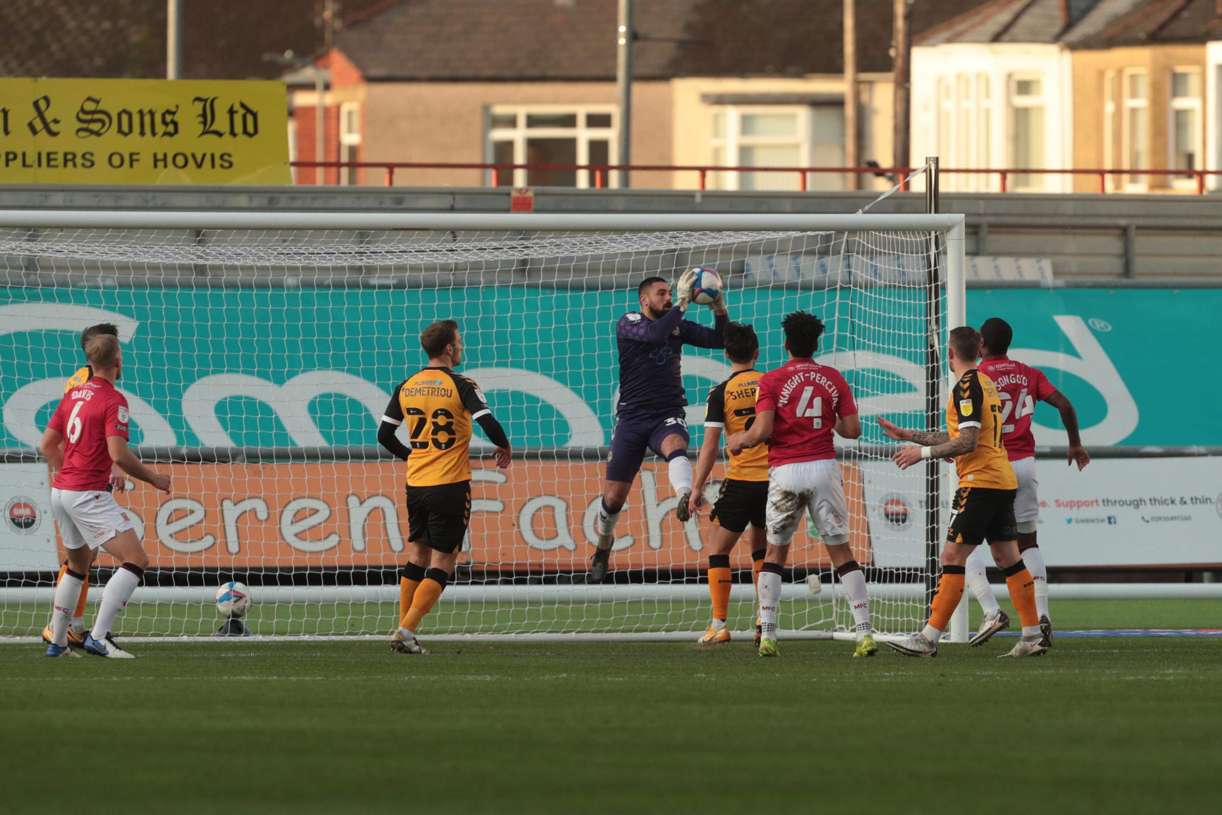 05.12.20 - Newport County v Morecambe - Sky Bet League 2 - Nick Townsend of Newport County saves from a Yann Songoo of Morecambe header
