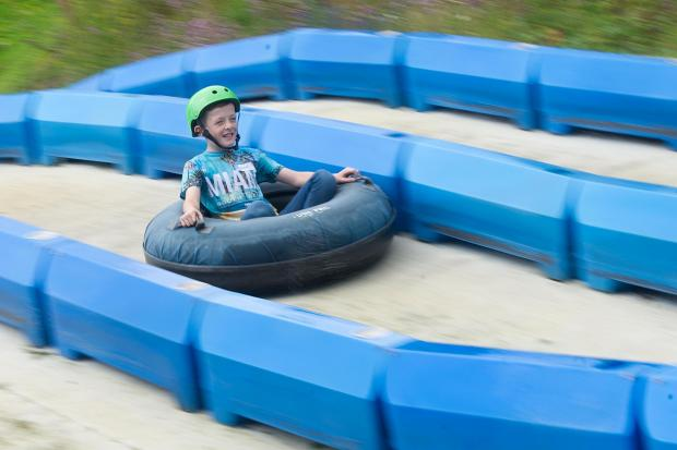 South Wales Argus: Wesley Ives enjoys himself tubing at a family day for families with autistic children and their siblings at Festival Park, Ebbw Vale..