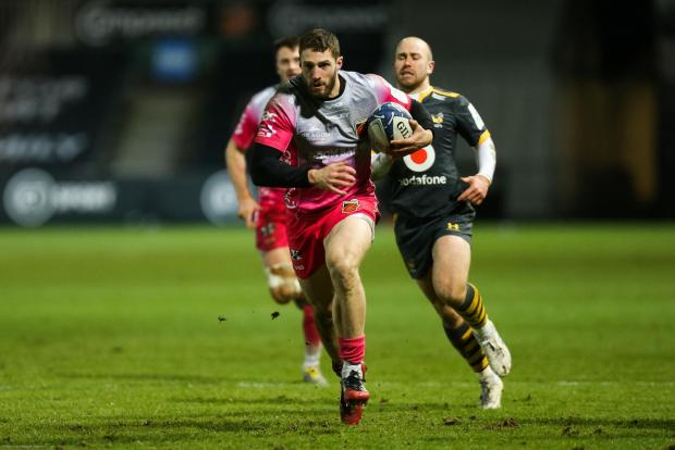 South Wales Argus: TRY: Jonah Holmes scores for the Dragons against his old club Wasps
