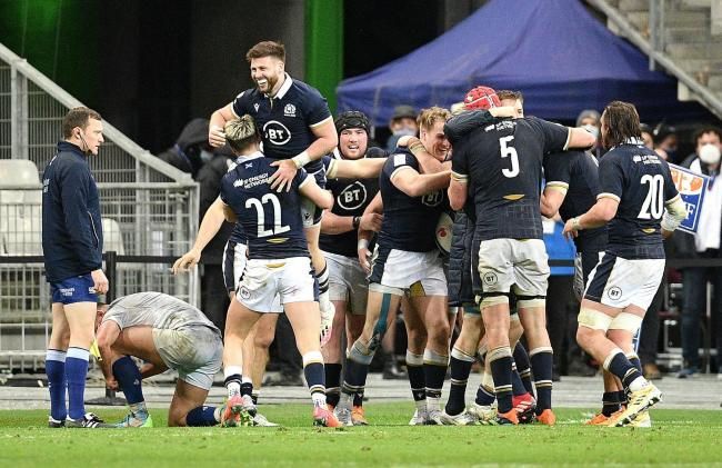 ELATION: Scotland's players celebrate Duhan Van Der Merwe's last-gasp winning try in Paris