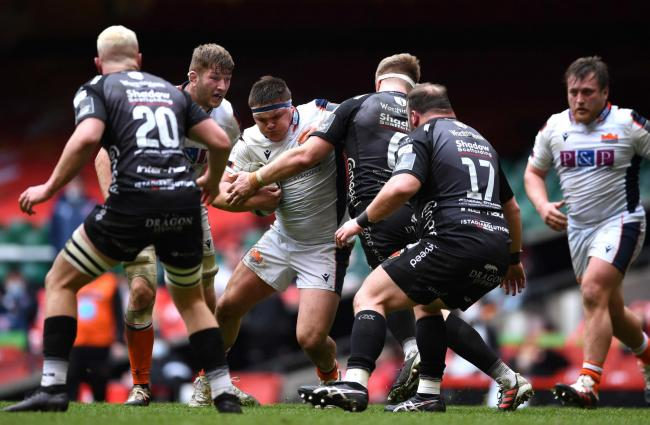 BIG EFFORT: Strong defence by the Dragons earned a deserved win against Edinburgh