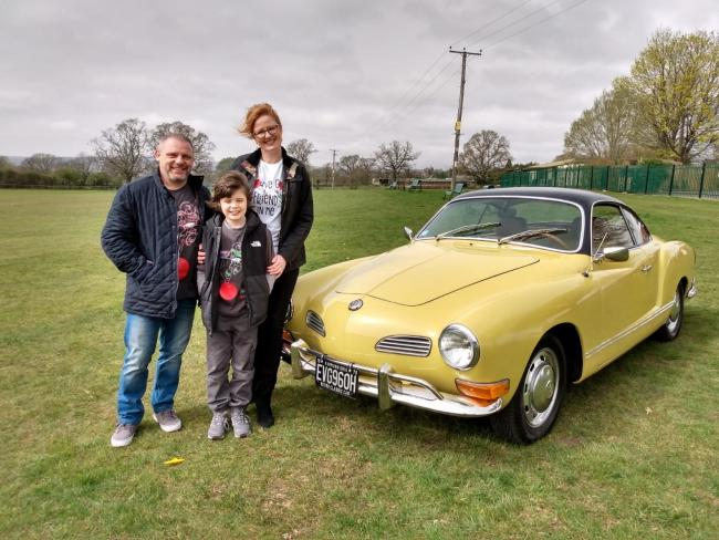 Nichy and Christian Williams with their son Ellis and their new vintage car.
