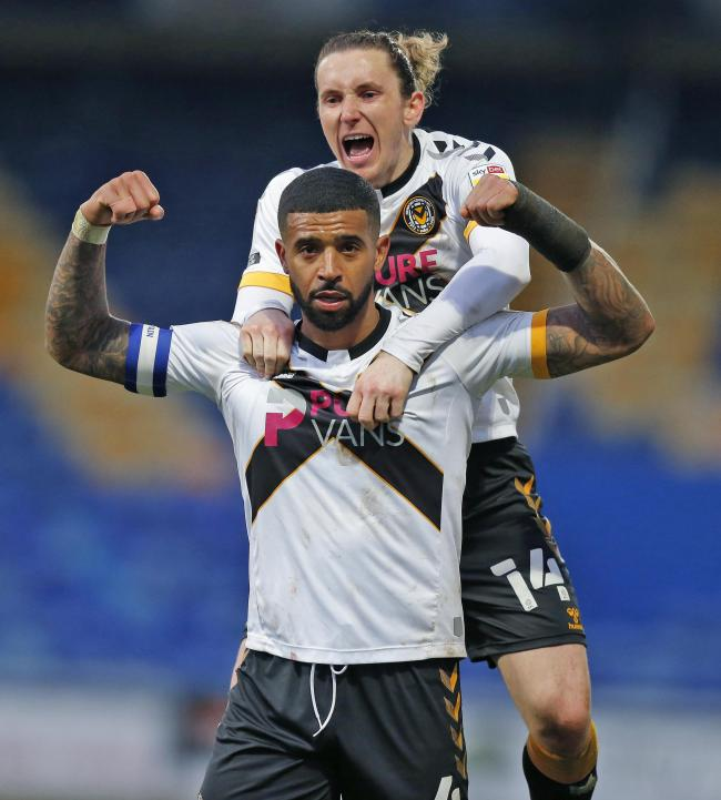 09.04.21 - Mansfield Town v Newport County - Sky Bet League 2 - Joss Labadie of Newport County celebrates scoring the 1st goal of the match with Aaron Lewis of Newport County on top