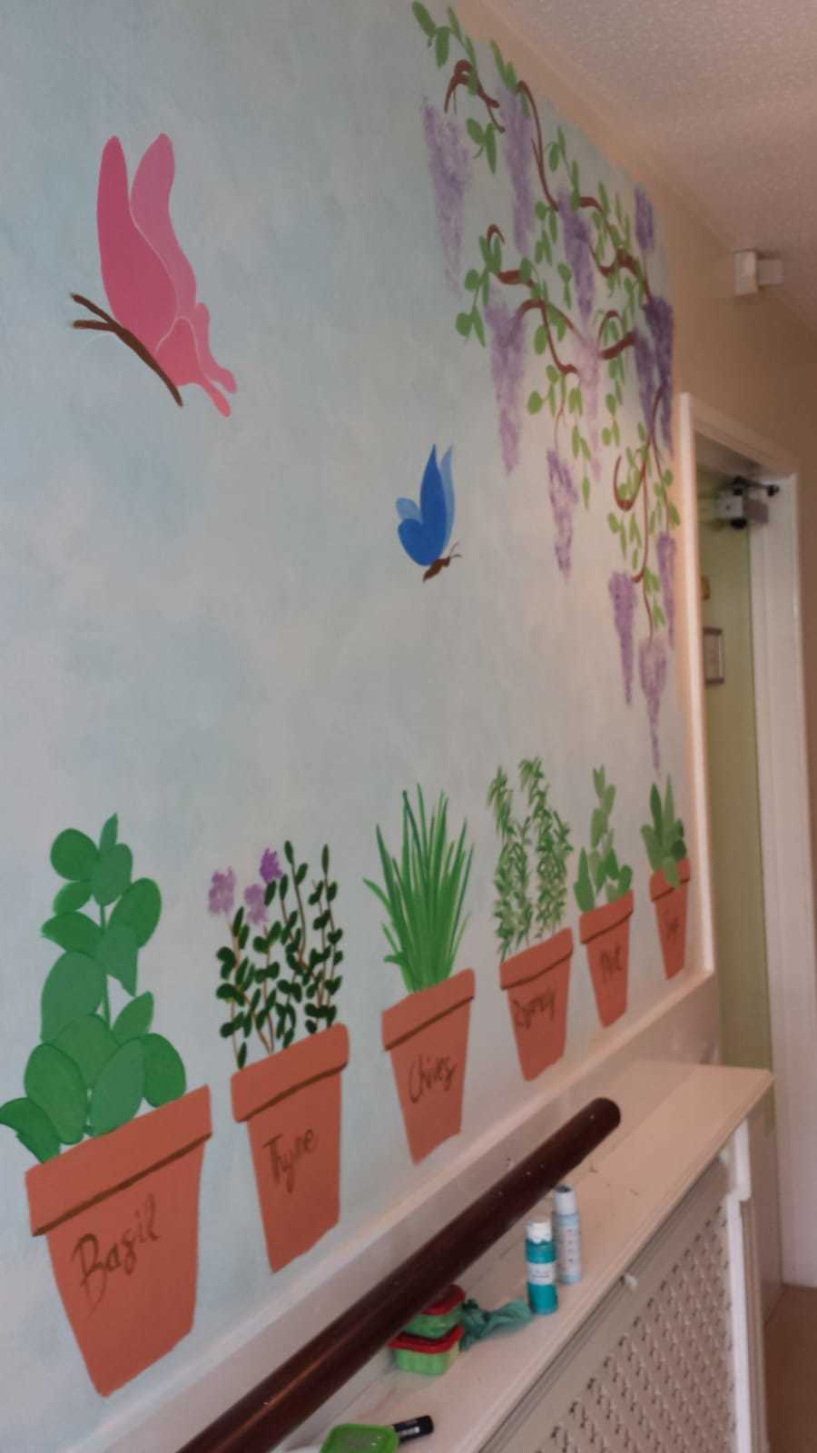 A mural leading outside at Thistle Court care home in Cwmbran, painted by staff member Rachel Davies. Picture: Thistle Court Care Home