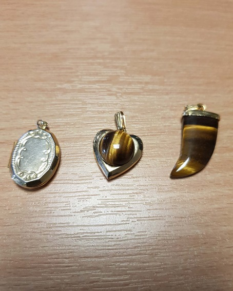 Gold heart charm with brown marble detail, gold locket pendant and horn pendant with brown marble detail